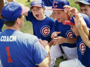 little-league-baseball-team-cheering-with-their-coach-300x224